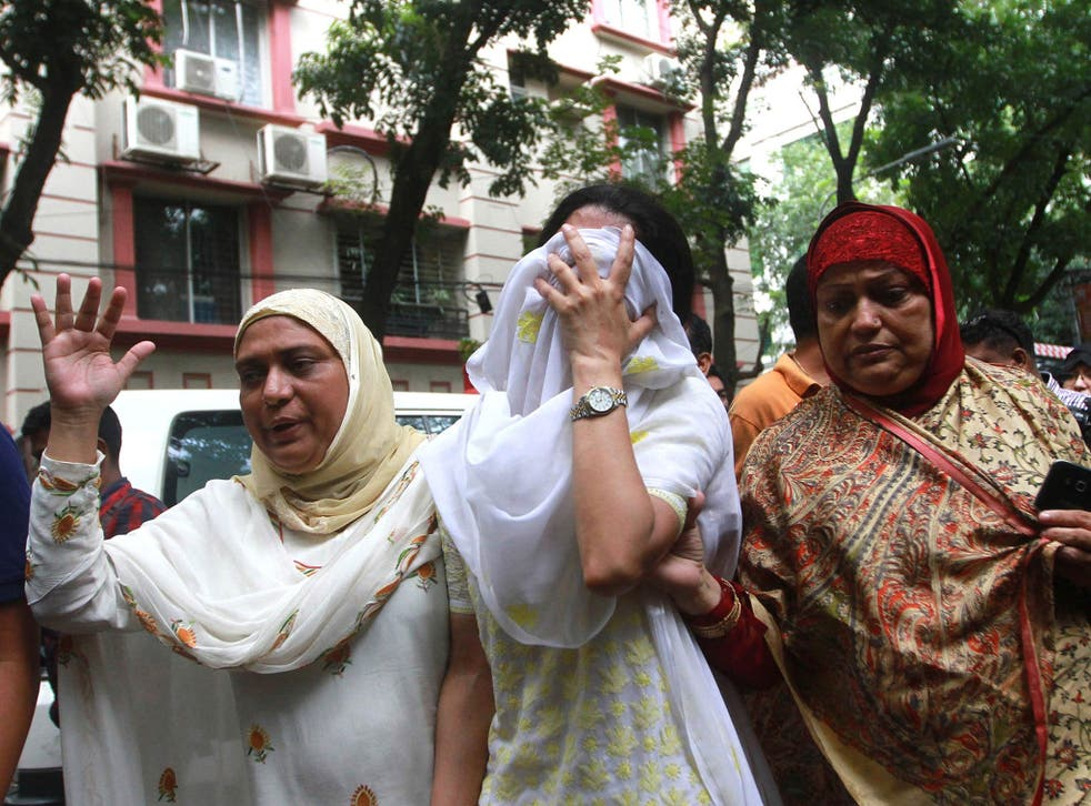 Relatives of the Dhaka terrorists attack victims mourn as they go to identify bodies from the Holey Artisan Bakery in Dhaka, Bangladesh