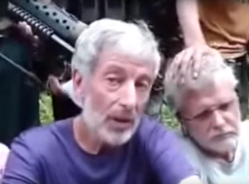 Canadian Robert Hall, left, was captured along with John Ridsdel, who was beheaded by Abu Sayyaf in April
