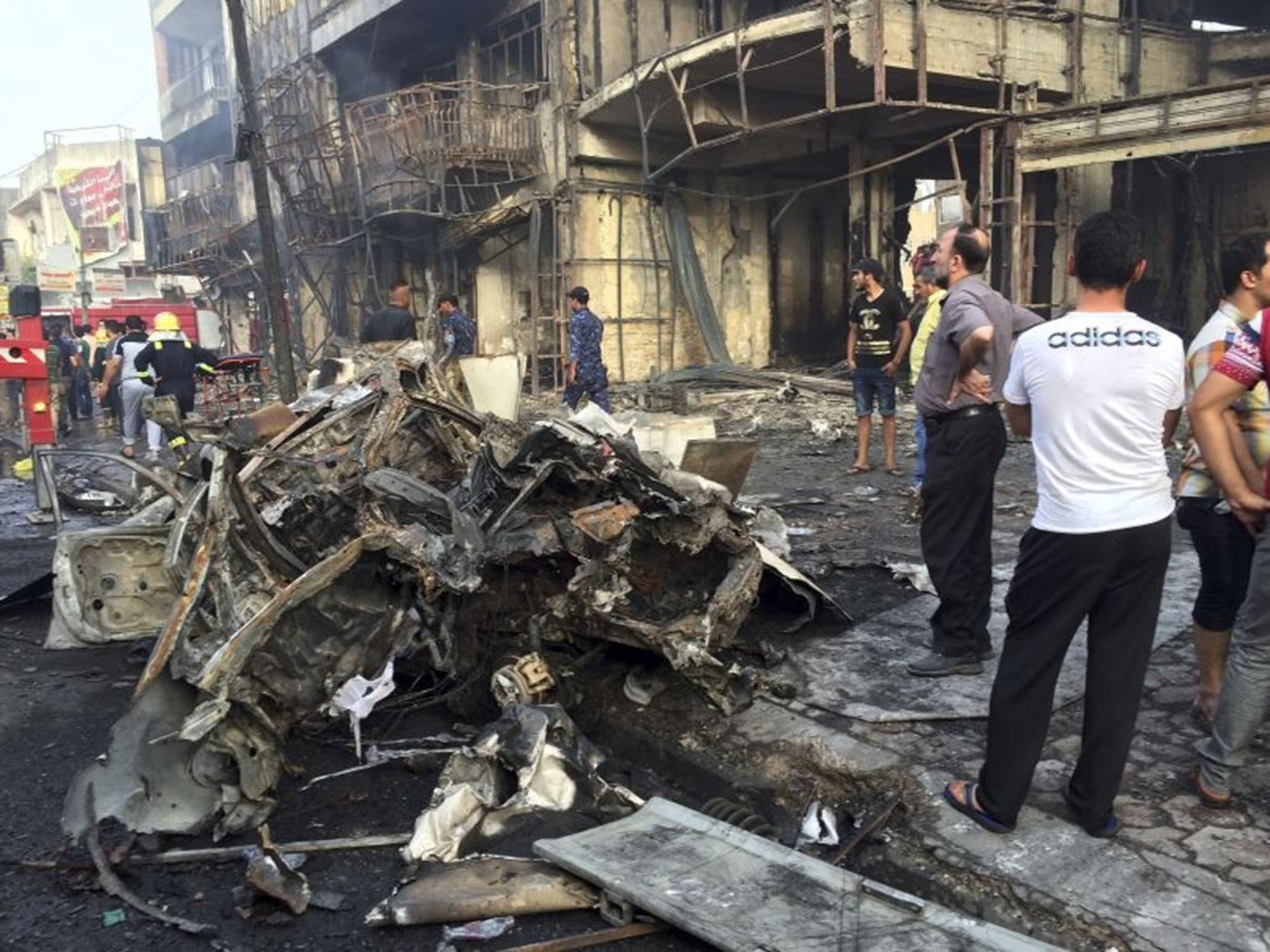 Baghdad attacks: Isis claims responsibility after at least