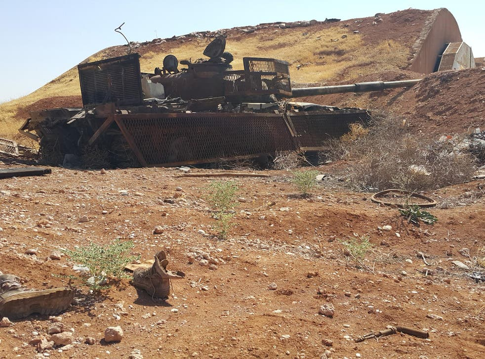 Remains of dead Isis fighters lie beside the wreckage of their suicide tank after they tried to crash through the wall of the Koyeress airbase. Photograph: Nelofer Pazira