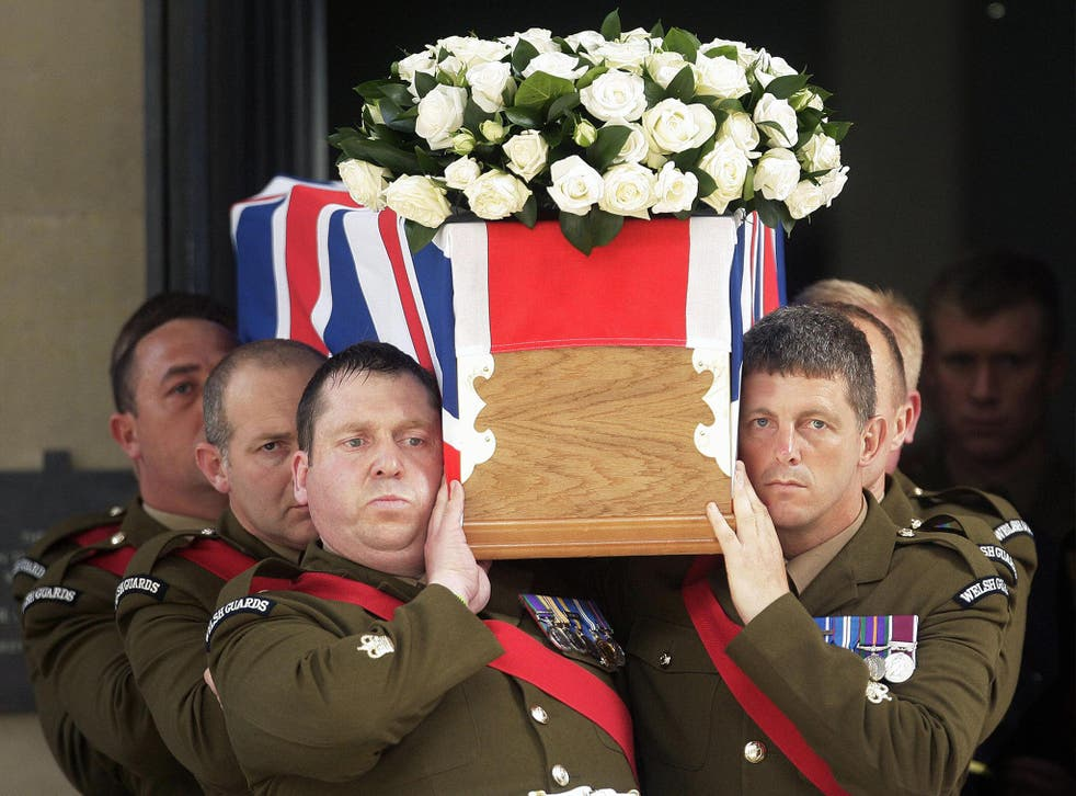 A coffin bearing the body of Britain's Lieutenant Colonel Rupert Thorneloe, of the 1st Battalion the Welsh Guards, is carried out of the Guards Chapel, in London, on July 16, 2009, after a funeral service.