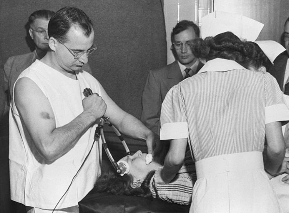 A doctor administers  'transorbital lobotomy' , or shock therapy at Western State Hospital in 1949