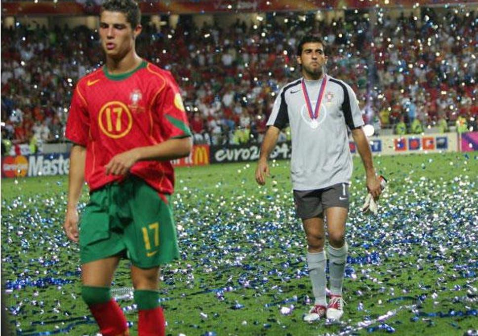 2797d97d5 Cristiano Ronaldo and Ricardo trudge from the field amid the tickertape  celebrating Greece s Euro 2004 final