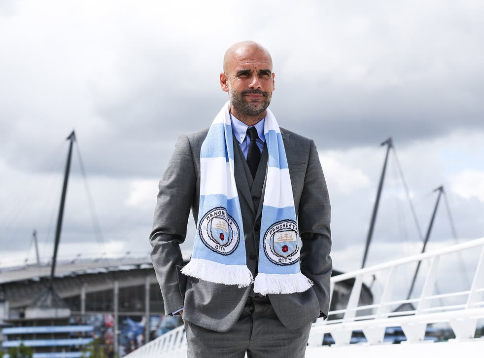 Pep Guardiola is pictured on Manchester City training complex after his press conference