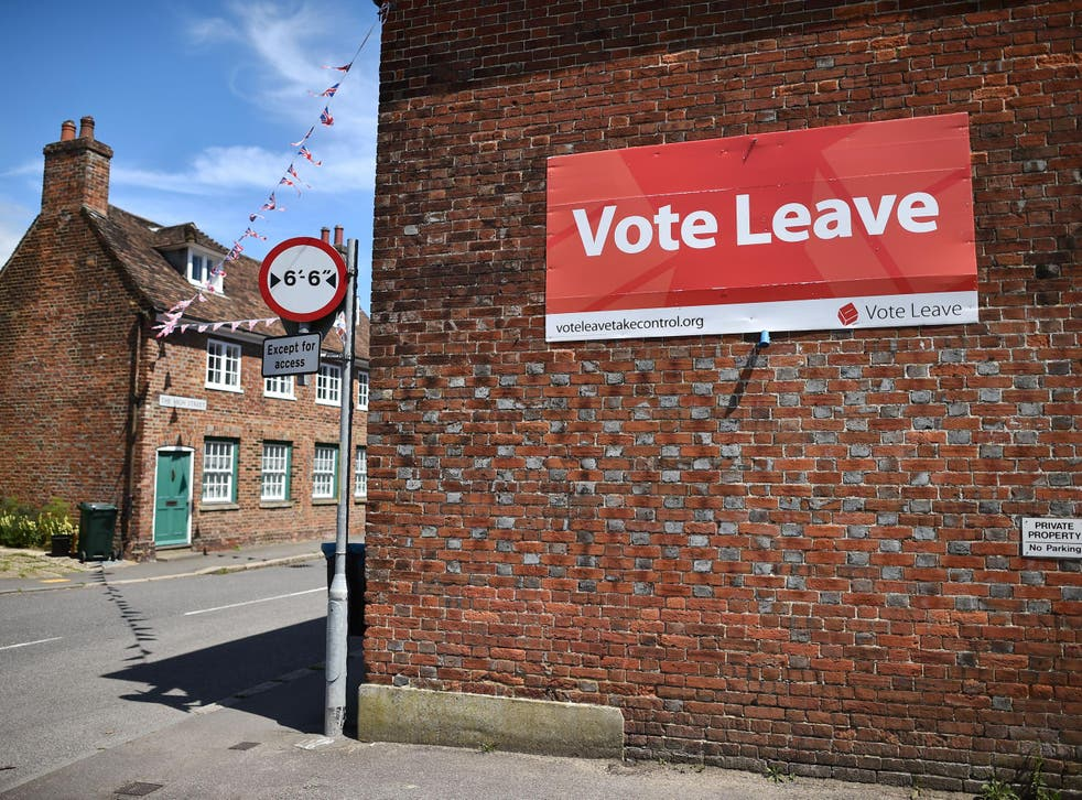 A 'Vote Leave' sign is seen on the side of a building in Charing on June 16, 2016 urging people to vote for Brexit