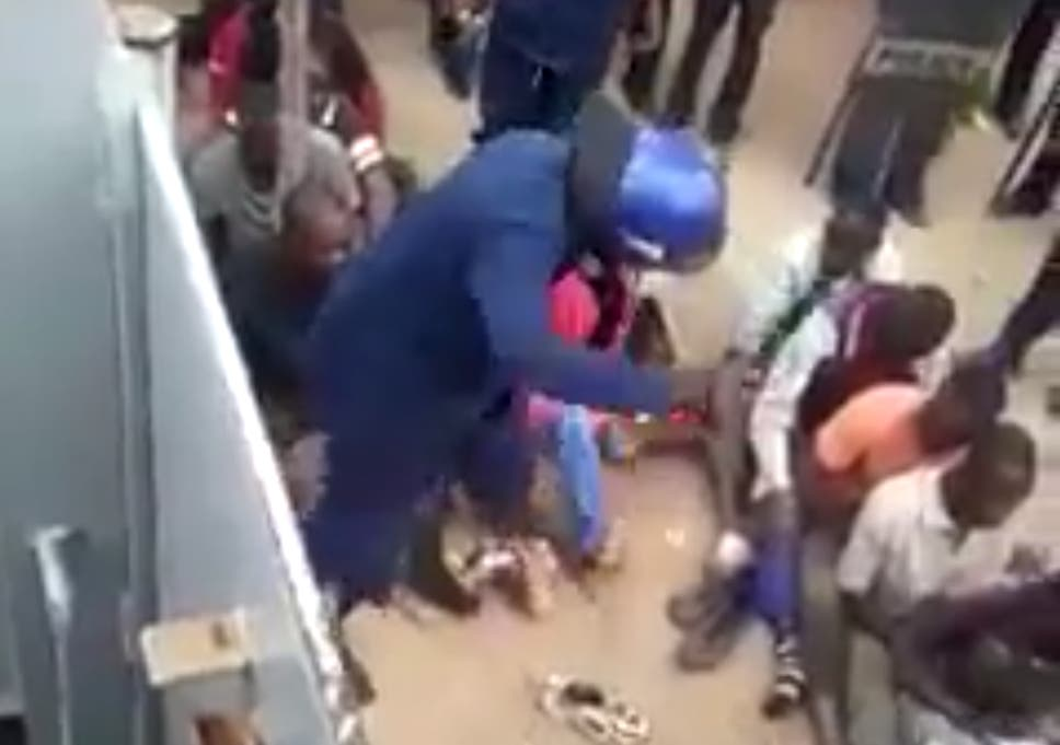 de0fc275f45 Zimbabwe police abuse mothers and children after protest in shocking video