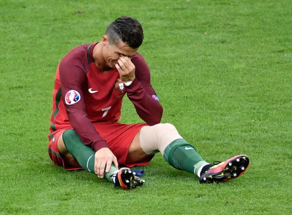Cristiano Ronaldo cries after injury forces him off during the Euro 2016 final