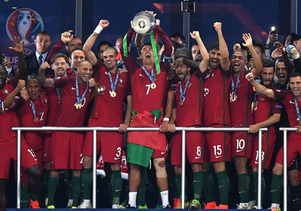 fae0d108810 Portugal players celebrate winning the European Championship with a 1-0  victory over France