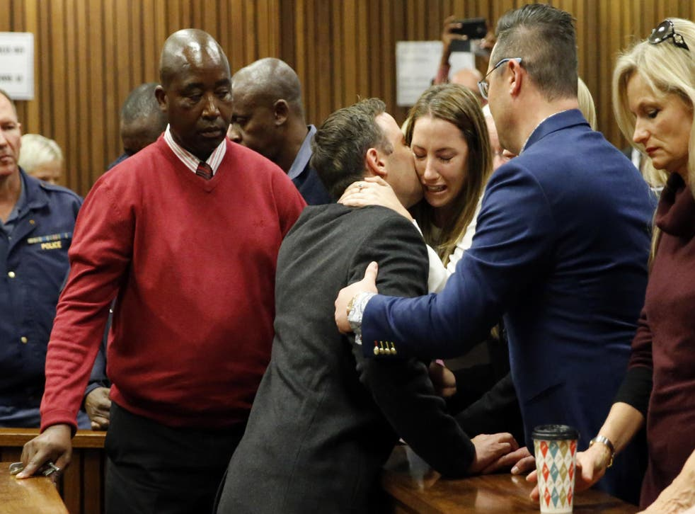 Aimee Pistorius cries as her brother is led to holding cells in Pretoria