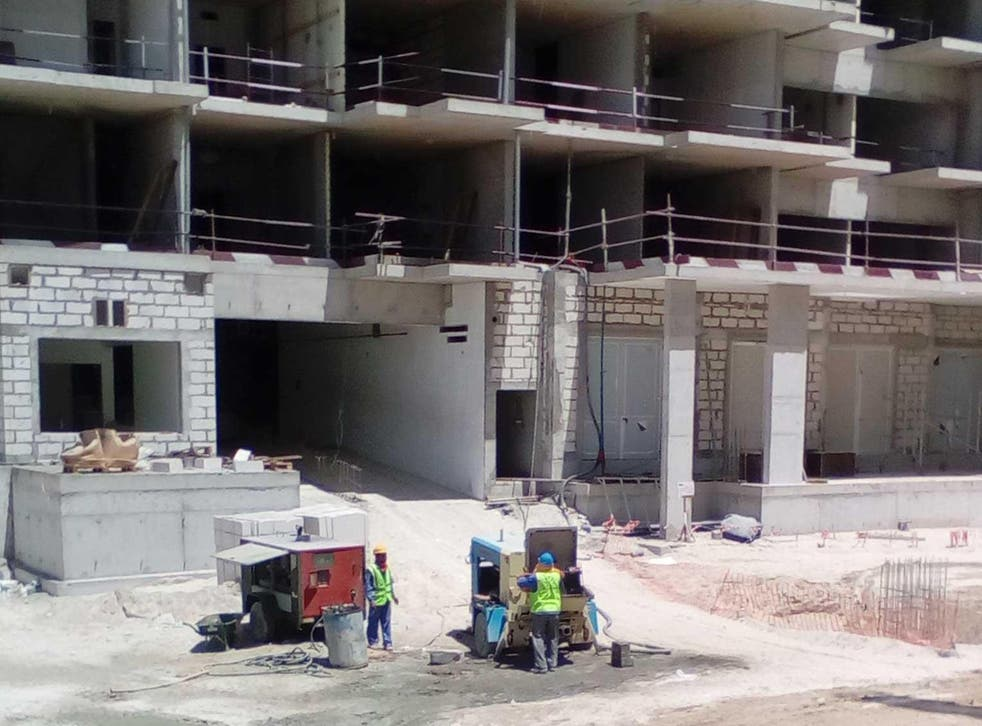 Workers on the Ansam residential project on the man-made Yas Island in Abu Dhabi