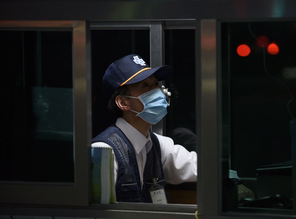 A security guard at Good Gang-an Hospital in Busan, South Korea during the 2015 Mers outbreak