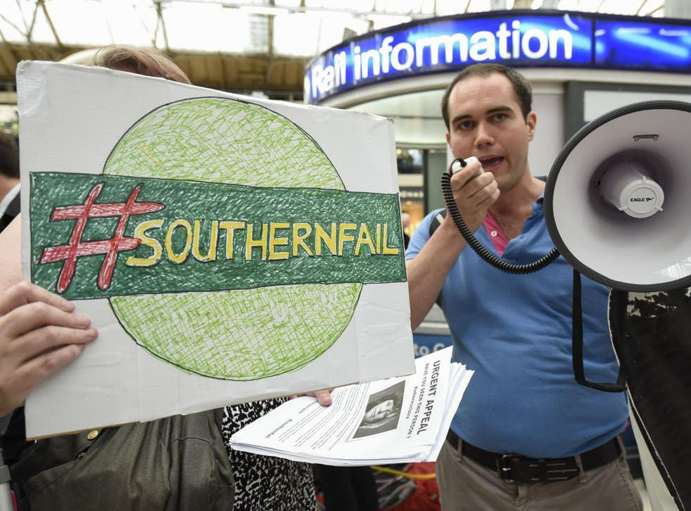 Passengers stage a 'fare strike' and protest at Victoria Station in central London in response to Southern Rail's owner, Govia Thameslink Railway, cutting 341 trains a day