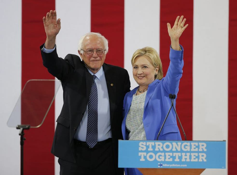 Democratic Presidential candidate Hillary Clinton with former Democratic Presidential candidate Bernie Sanders