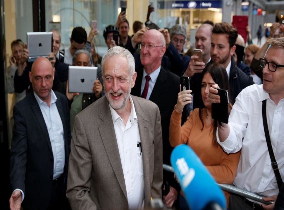 Supporters of Labour leader Jeremy Corbyn greet him after the announcement that he is allowed by the NEC to stand in the party's leadership election without needing to secure nominations
