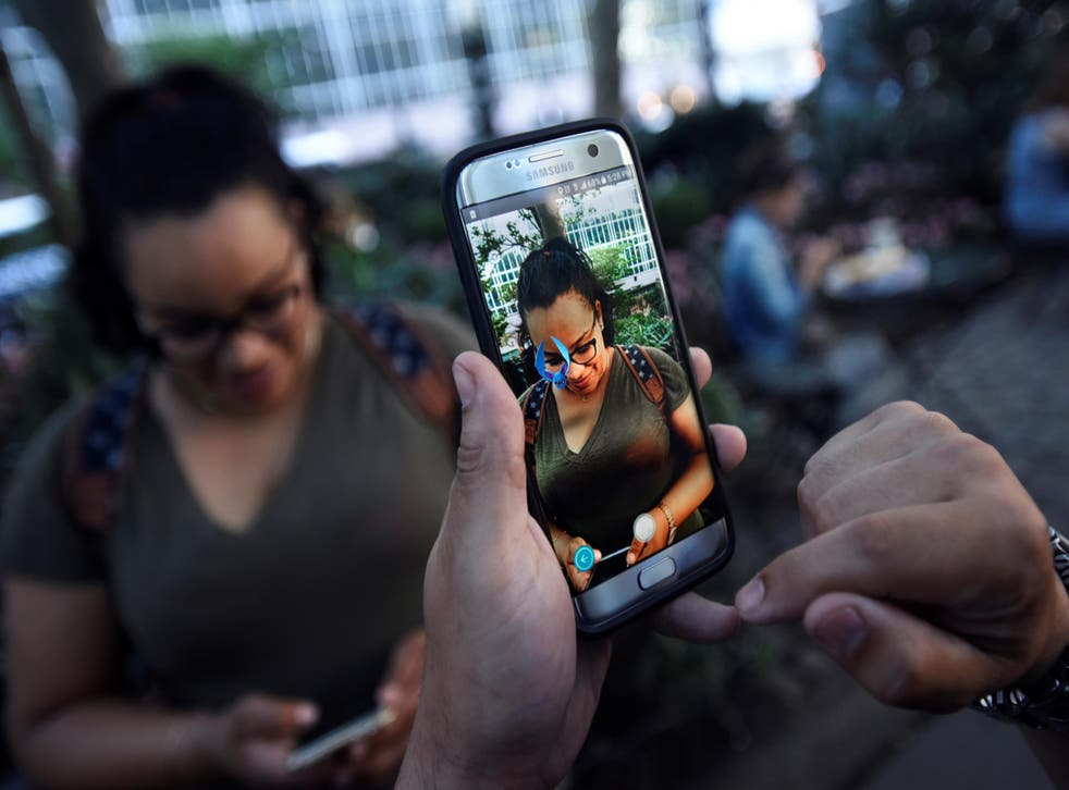 Part of the game involves capturing virtual Pokémon, visible only when looking at your surroundings through a smartphone