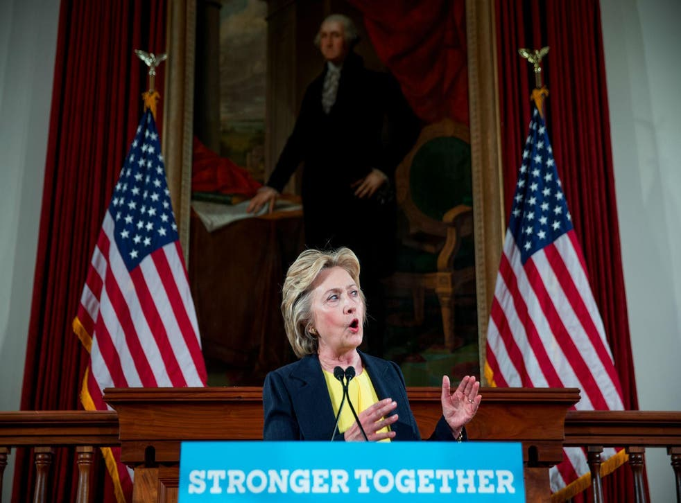 Hillary Clinton speaks beneath a portrait of George Washington at the Illinois Old State House in Springfield