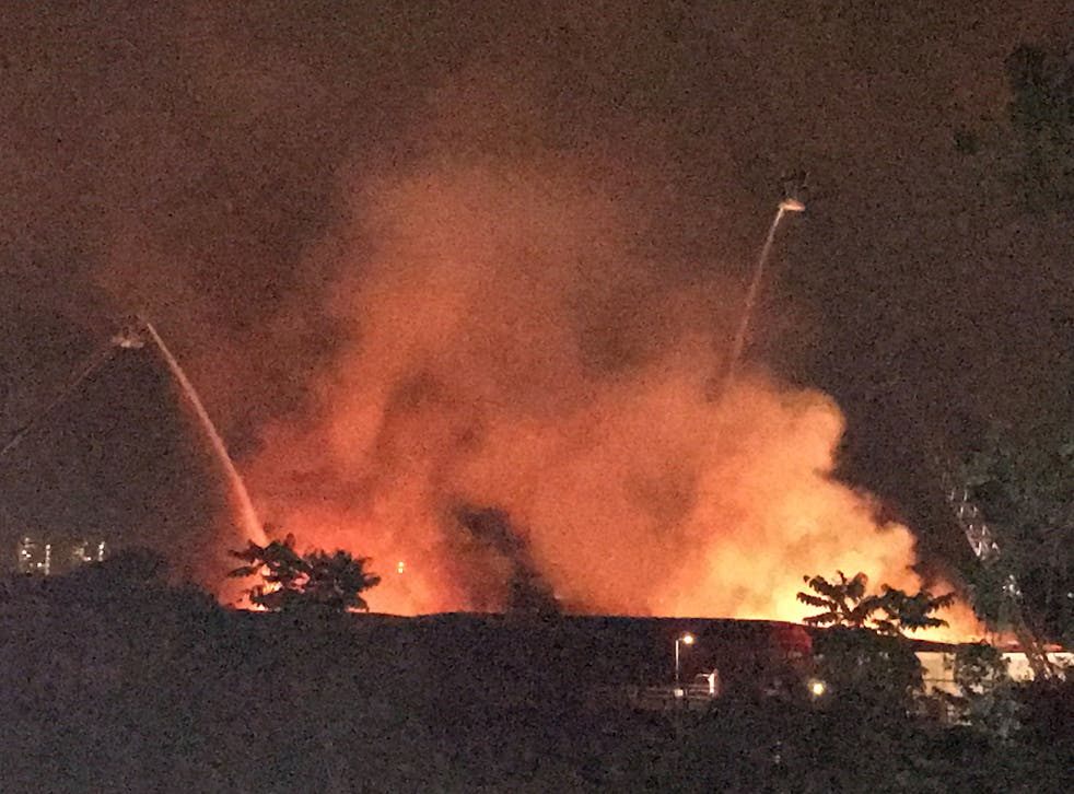 Around 100 firefighters were called to tackle the fire