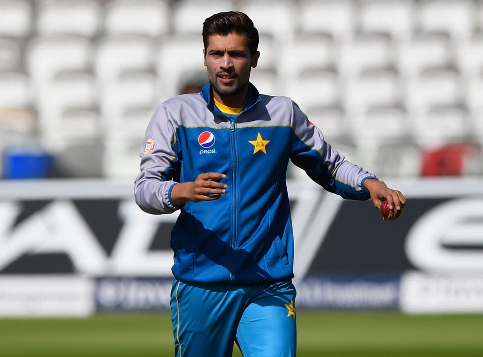 Mohammad Amir inspects the Lord's wicket