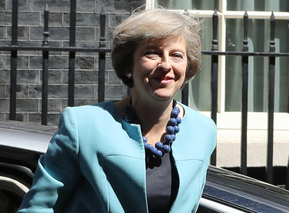 British Prime Minister Theresa May arrives at 10 Downing Street to appoint her cabinet