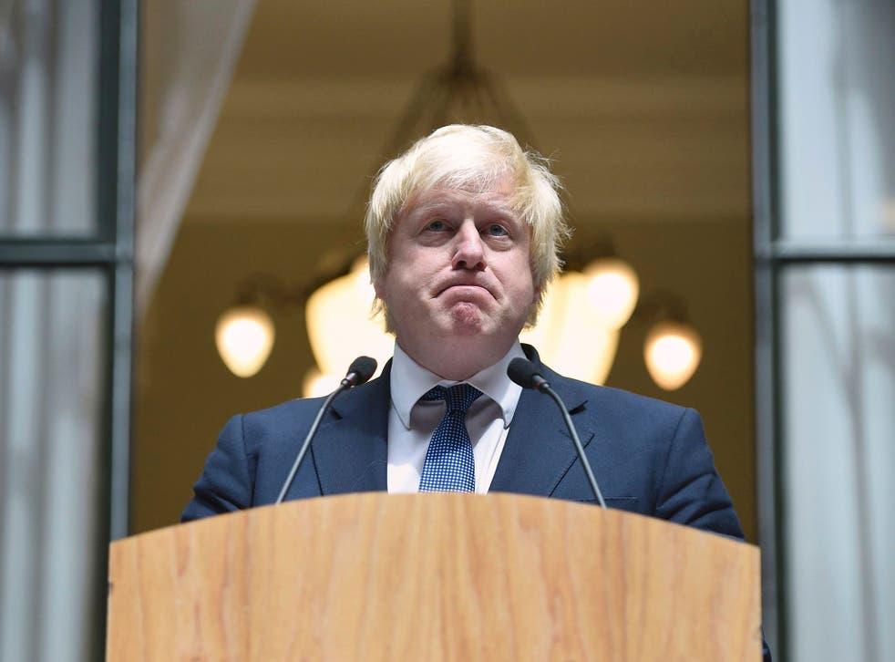 Boris Johnson addresses staff inside the Foreign Office