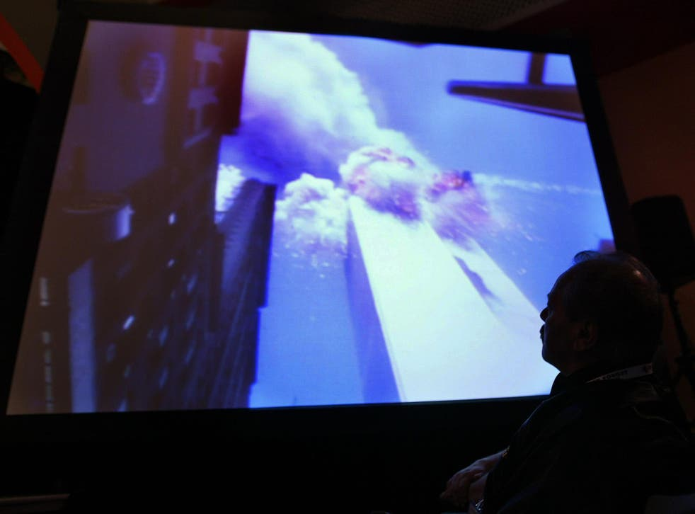 Investigators and victims' families watch footage of the New York City attack during a 9/11 Commission hearing