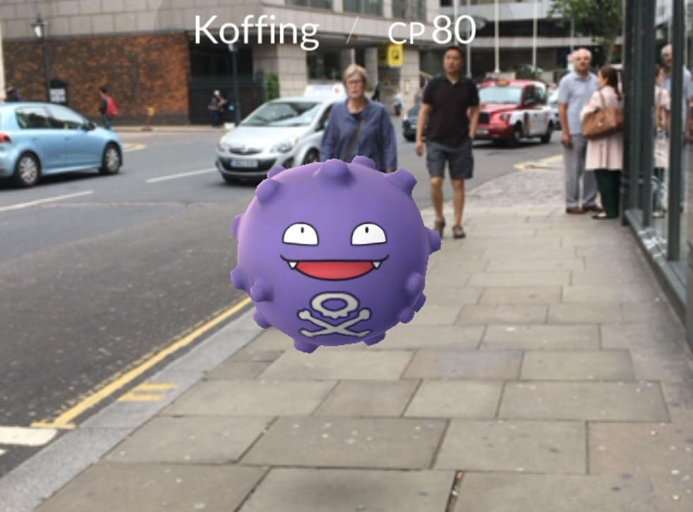 Players catch Pokemon characters which appear on the screen of a smartphone