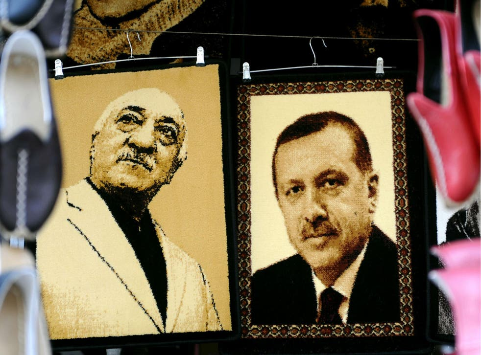 Embroidered images of United States-based Turkish cleric Fethullah Gulen (L) and Turkey's Prime Minister Recep Tayyip Erdogan (R) are displayed in a shop in the Gaziantep market on January 17, 2014