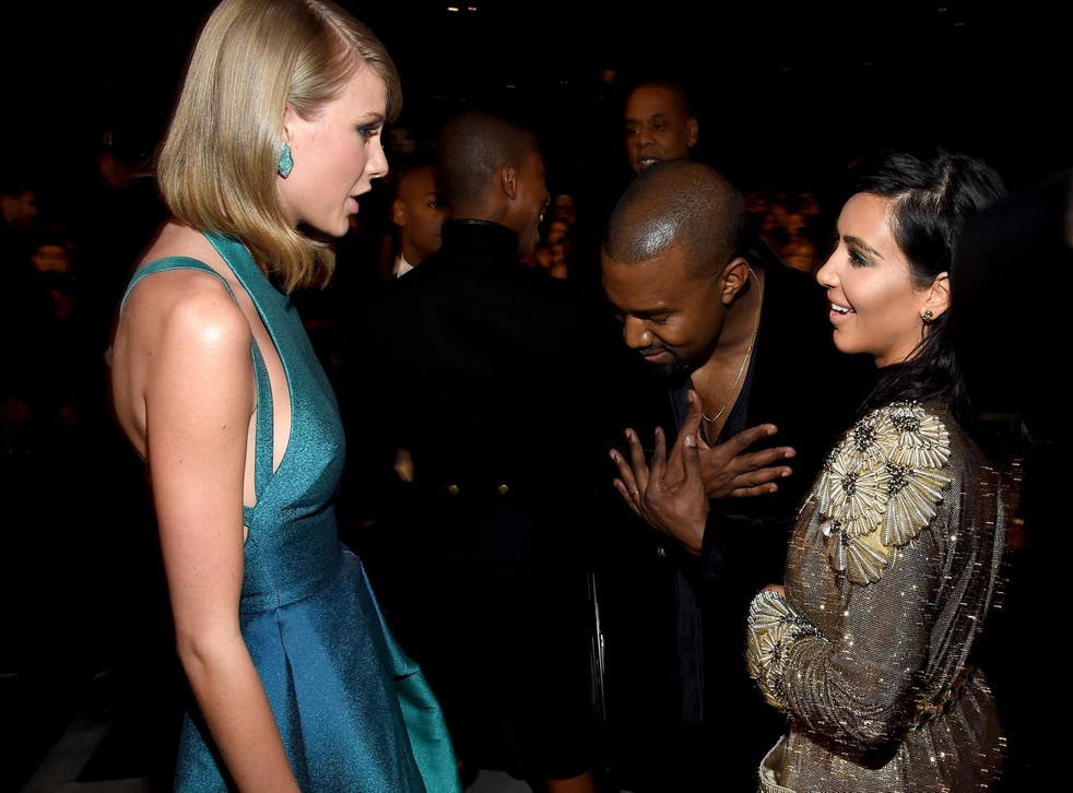 Taylor Swift, Kanye West and Kim Kardashian chat at the Grammy awards in February, 2015