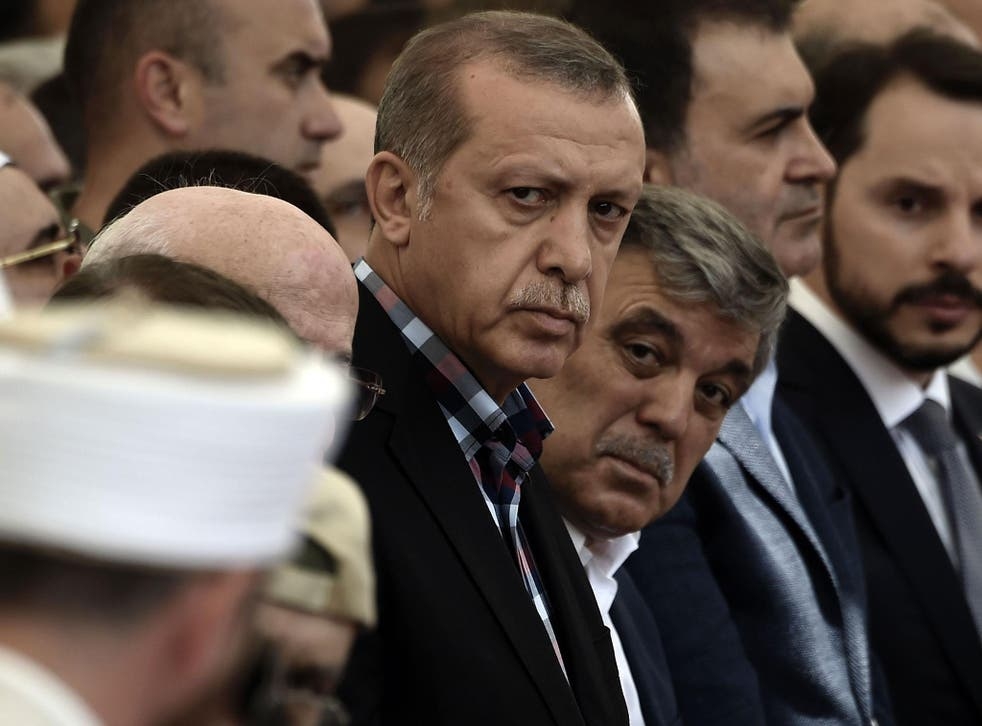 Turkish President Recep Tayyip Erdogan and former Turkish president Abdullah Gul attend the funeral of a victim of the coup attempt in Istanbul on 17 July, 2016