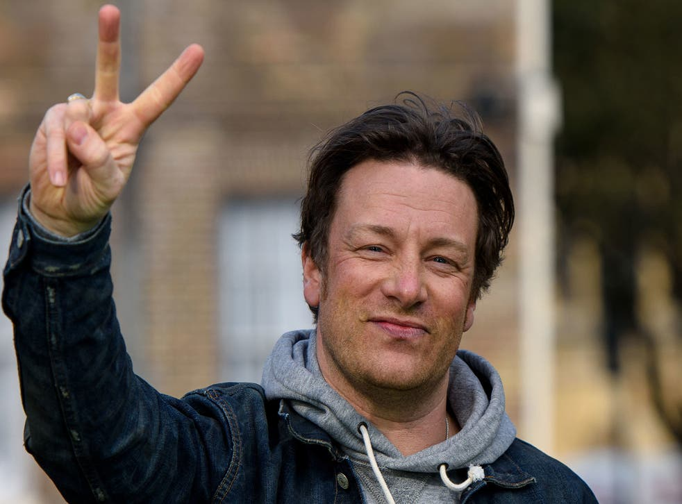 Jamie Oliver tries to keep the peace with fellow chef Gordon Ramsay