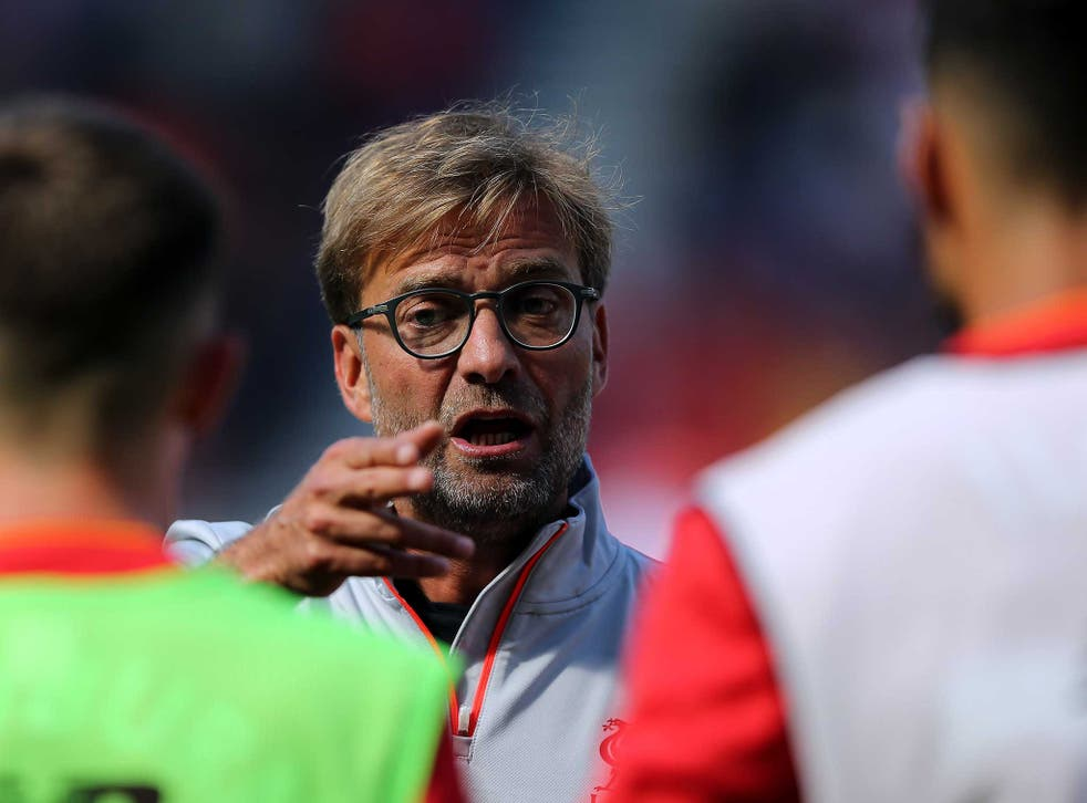 Jurgen Klopp gives his players instructions during Liverpool's victory against Wigan