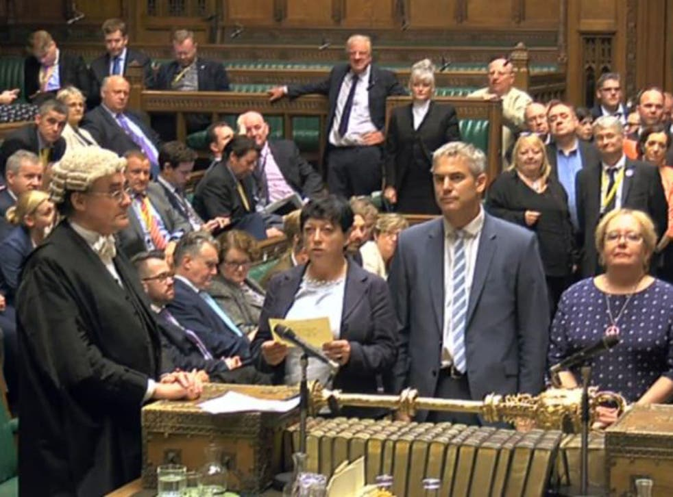 The result of a vote by MPs on whether to replace the Trident weapons system is read out in the House of Commons in London during a debate on whether to renew the Trident nuclear deterrent.