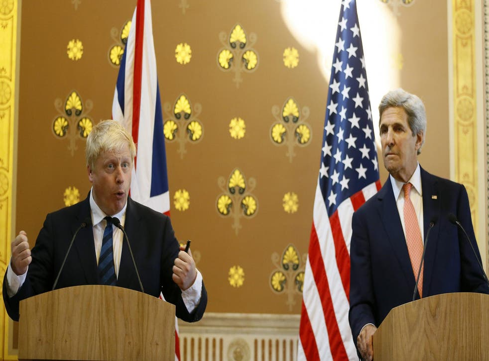 Foreign Secretary Boris Johnson, left, and US secretary of state John Kerry hold a press conference at the Foreign Office in London.