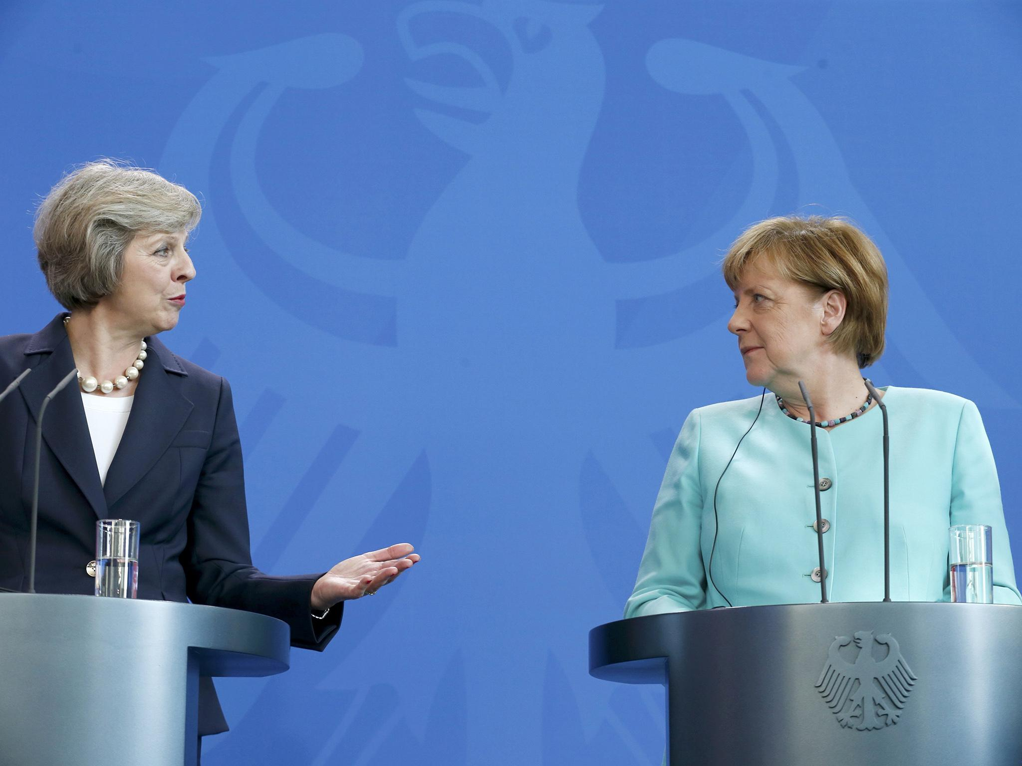 Brexit talks will begin in 'next couple of weeks', Theresa May and Angela Merkel agree