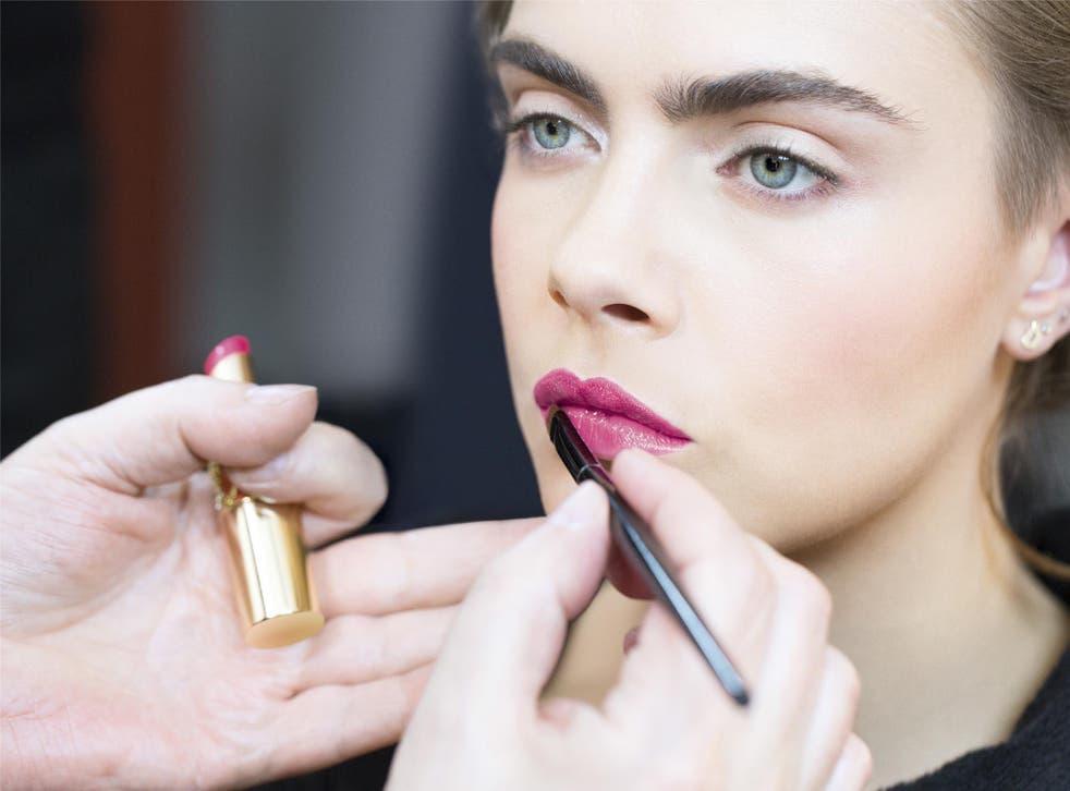 Cara Delevingne wearing Yves Saint Laurent's Rouge Volupté Shine in Star