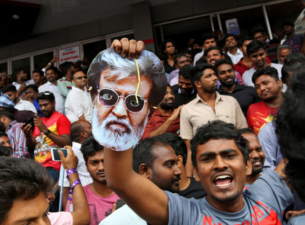 Rajinikanth fans leave a cinema in Chennai, India, after watching the actor's new movie 'Kabali'