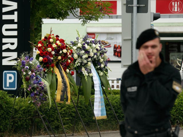 A police officer guards the scene of the attack where nine people died