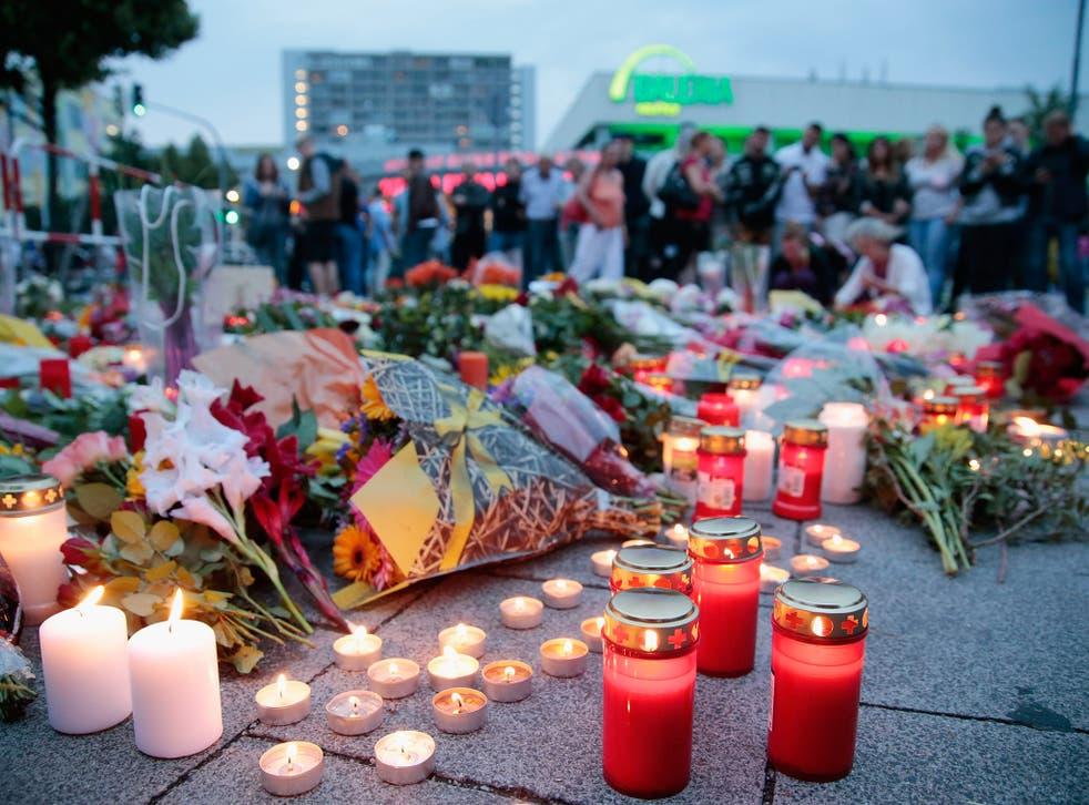 Tributes to those killed in Munich by gunman Ali David Sonboly