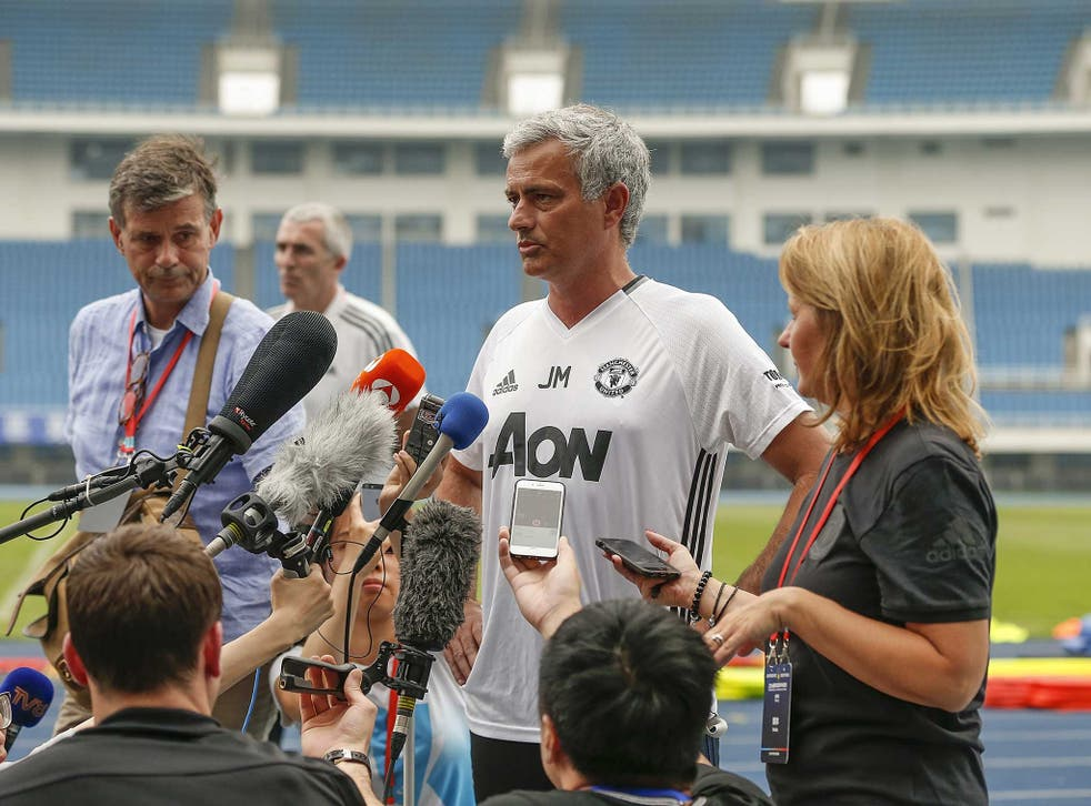 Jose Mourinho speaks to the media outdoors in bizarre scenes in China