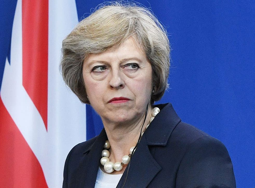 Theresa May speaks to the media outside Downing Street
