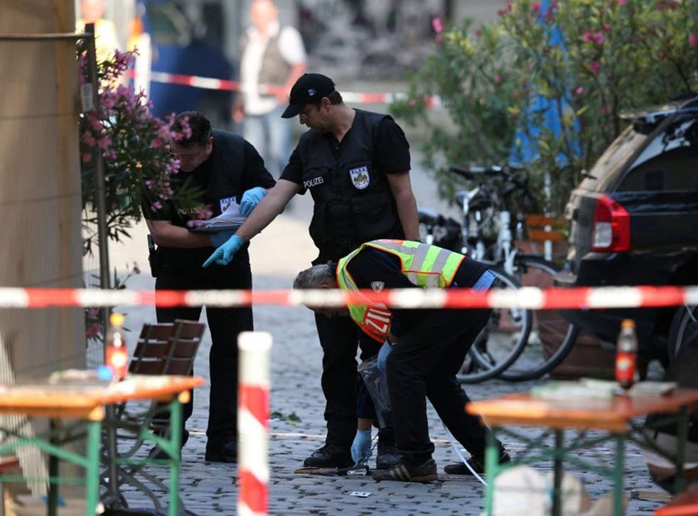 Police officers operate on a scene following an explosion in Ansbach, Germany, 25 July, 2016