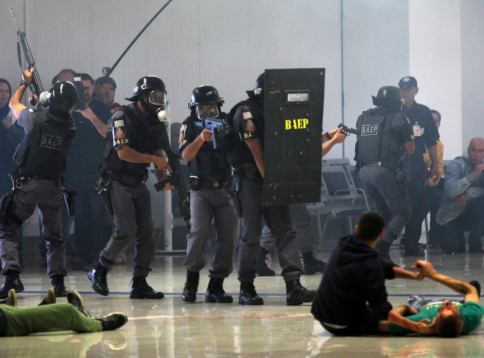 Sao Paulo state police take part in a simulated hostage situation during a security exercise ahead of the 2016 Rio Olympics