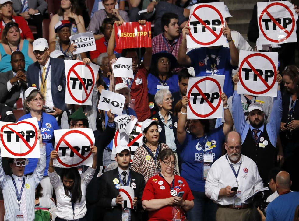 Delegates protest the Trans-Pacific Partnership on convention floor