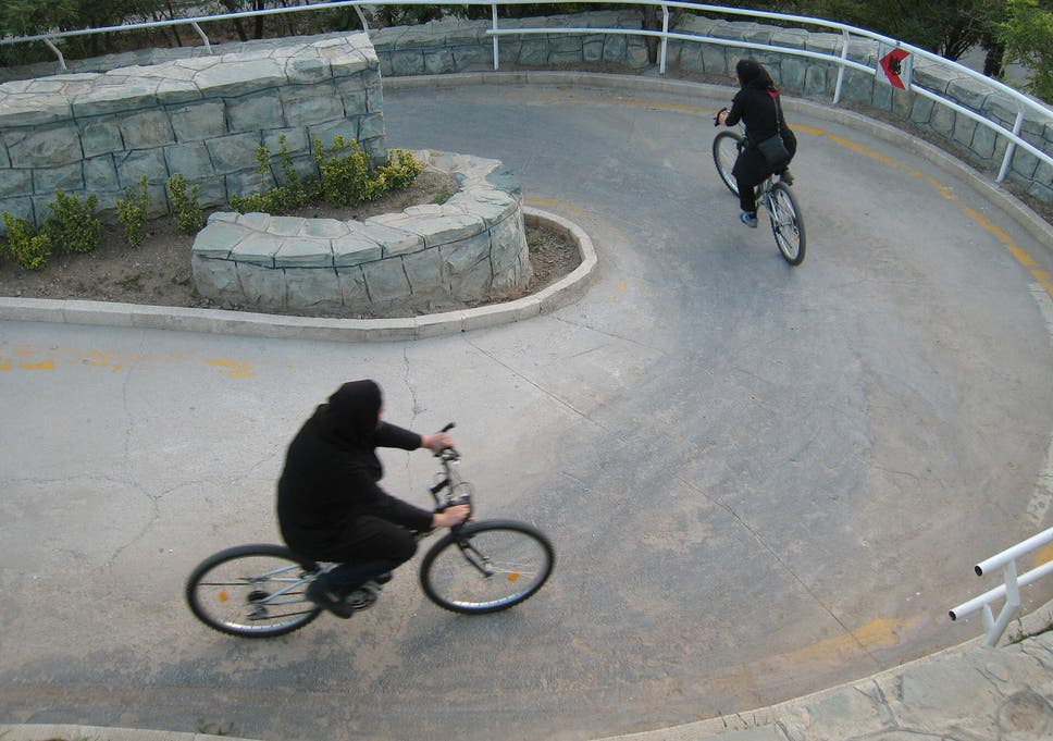 3199108d2c5 Iranian women ride their bicycles at Tehran's 'Mothers' Paradise' park,  which is