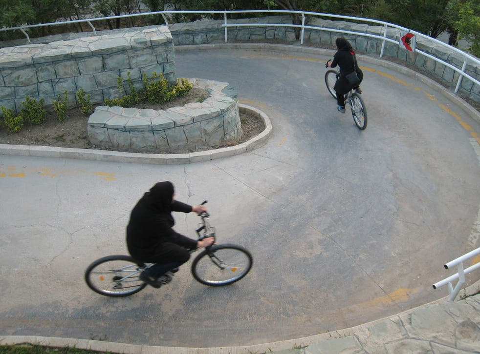 Iranian women ride their bicycles at Tehran's 'Mothers' Paradise' park, which is the Iranian capital's women-only public recreation area, on June 13 2008.