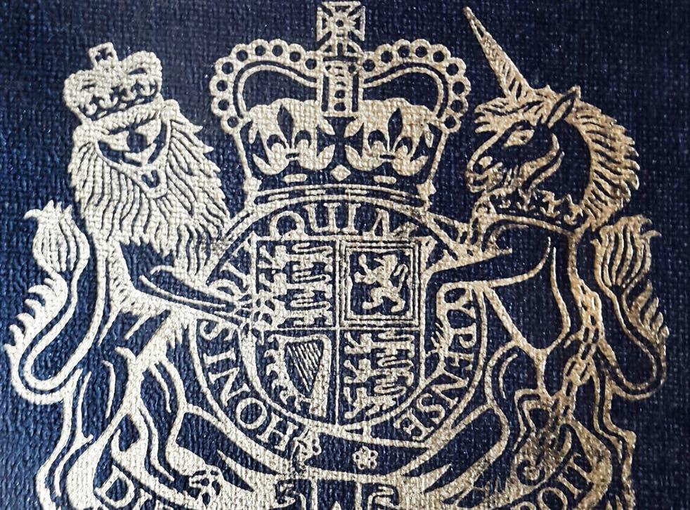 A close up of an old British passport