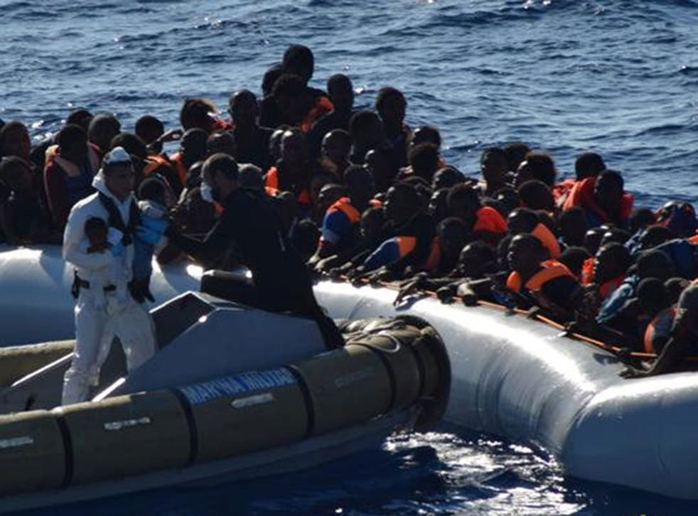 Babies are taken off a boat during a refugee rescue operation off the coast of Sicily last month