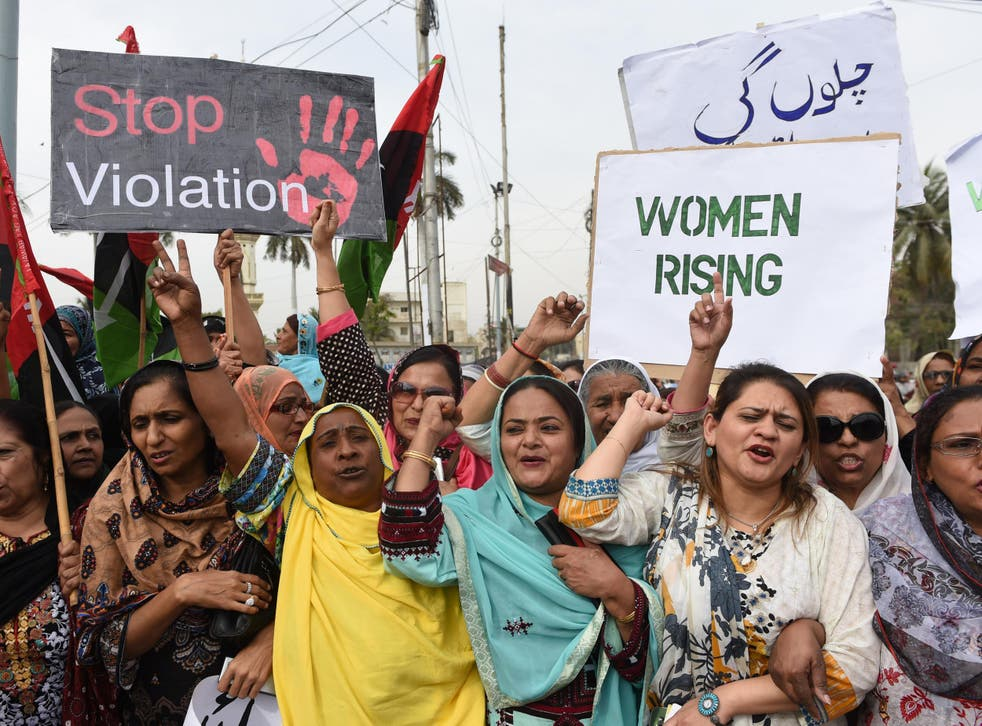Activists of The Pakistan People's Party (PPP) hold placards as they march during a rally to mark International Women's Day in Karachi