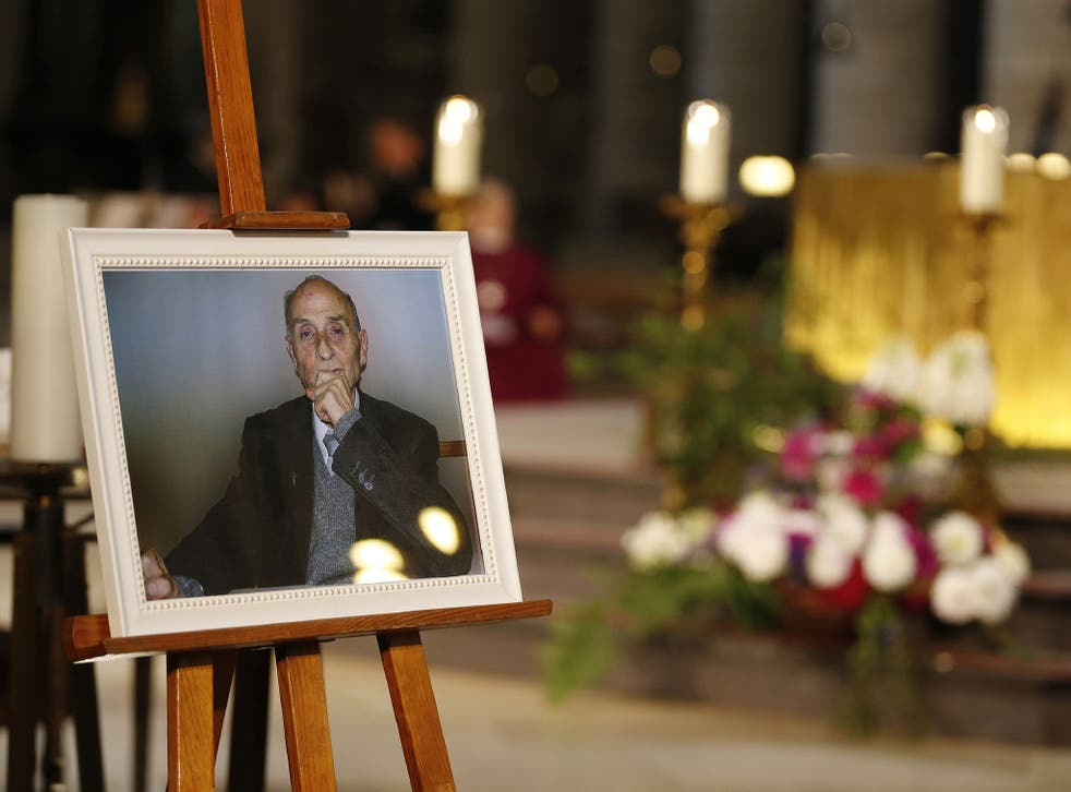Hundreds of people watched the funeral ceremony for Father Jacques Hamel on a big screen outside the cathedral