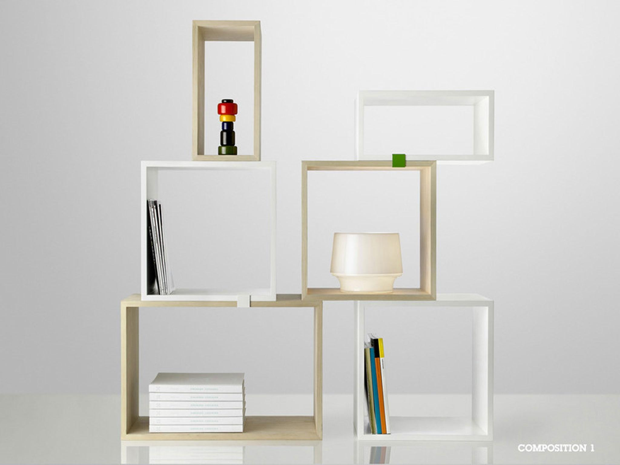 Small coloured clips make these boxes stack together as shelves the system can be as big or small as you like and because they are not wall mounted